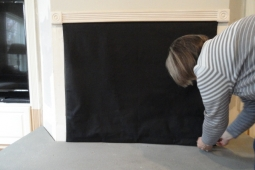 FIREPLACE FASHION COVER BEING INSTALLED