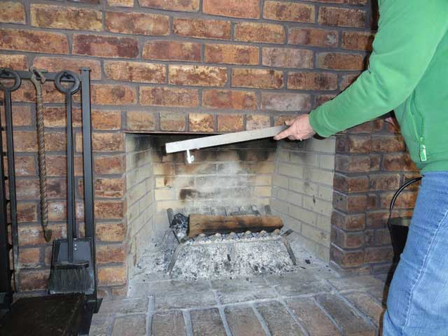 Insert angle adapter bar into top of fireplace